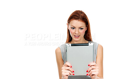 Buy stock photo A young woman holding her digital tablet in front of her