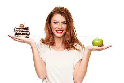 Buy stock photo A confused young woman trying to choose what to eat