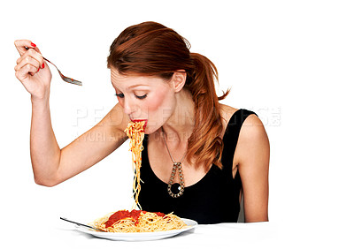 Buy stock photo A young woman trying to eat her spagetti without making a mess