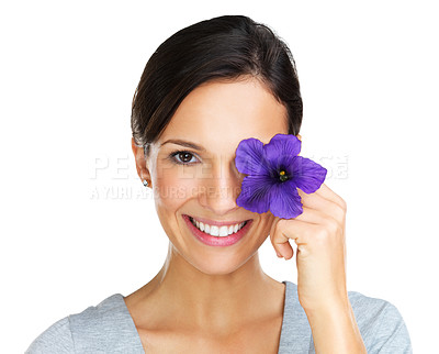 Buy stock photo Lovely young brunette holding up a purple hibiscus flower in front of her face