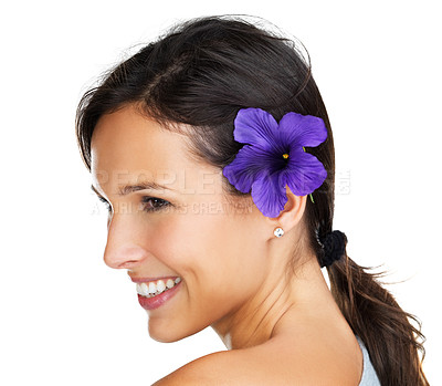 Buy stock photo Gorgeous brunette looking out of the frame with a purple flower behind her ear