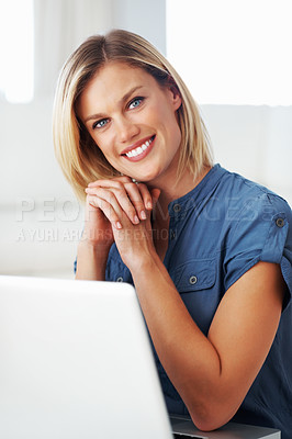 Buy stock photo Portrait of gorgeous middle aged woman smiling while using laptop