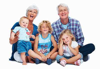Buy stock photo Portrait of a senior couple spending time with grandchildren over white background
