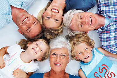 Buy stock photo Top view of happy multi generation family lying down together