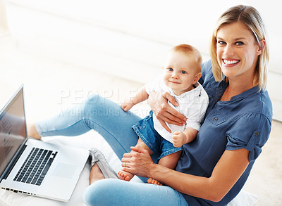 Buy stock photo Portrait of a beautiful woman smiling with her cute baby on her lap