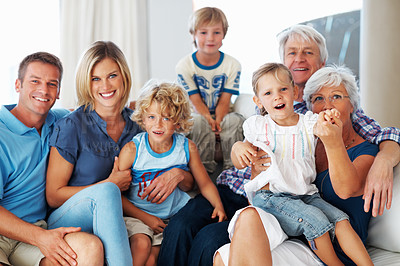 Buy stock photo Portrait of happy three generation family spending time together at home
