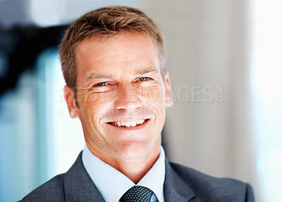 Buy stock photo Closeup of handsome happy male executive smiling