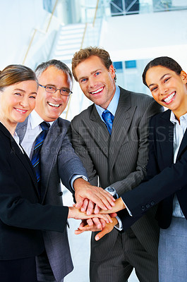Buy stock photo Handshake and teamwork. A group of business people making a pile of hands in a light and modern office