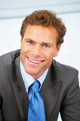 Buy stock photo Standing business man, leaning over his desk
