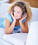 """Closeup of beautiful young lady listening to music"