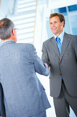 Buy stock photo Business handshake and trust. Two businessmen shaking hands in a light and modern office.