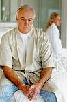 Senior man in thought , having conflict with wife