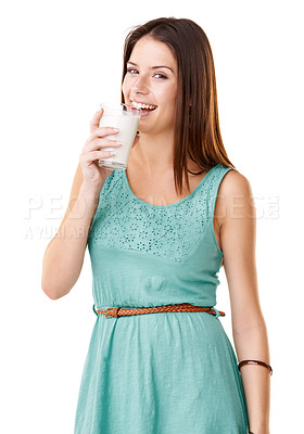 Buy stock photo Studio portrait of an attractive young woman drinking a glass of milk isolated on white