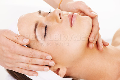 Buy stock photo Cropped shot of a young woman getting a beauty treatment isolated on white