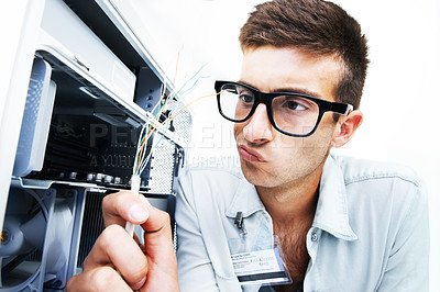 Buy stock photo A technician working with wires on fixing an electrical appliance