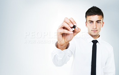 Buy stock photo Full length studio portrait of a young man holding a marker about to write something