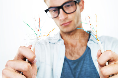 Buy stock photo A technician working on frayed wires