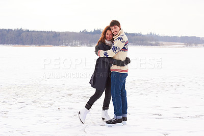 Buy stock photo A young couple on an ice skating date at a frozen natural lake