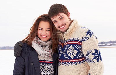 Buy stock photo Shot of a sweet young couple outdoors in the snow