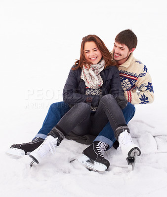 Buy stock photo Young couple laughing and being silly on the ice of a natural frozen lake outdoors