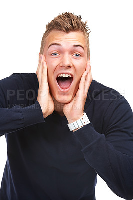 Buy stock photo Studio portrait of an excited young guy yelling in surprise against a white background