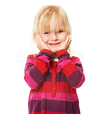 Buy stock photo Studio shot of a cute little blonde girl standing with her head in her hands