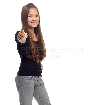 Buy stock photo Studio portrait of a confident teenage girl pointing to the camera against a white background
