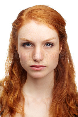 Buy stock photo An attractive redhead looking at the camera with a serious expression