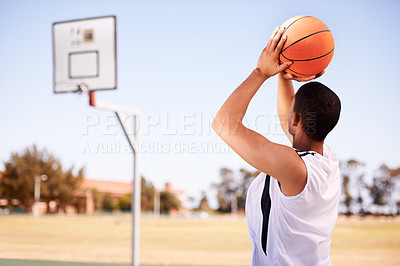 Buy stock photo A basketball player attempting a sideways shot