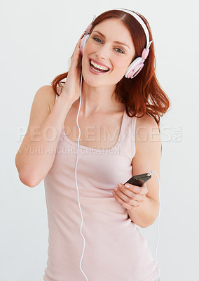 Buy stock photo A young woman listening to music