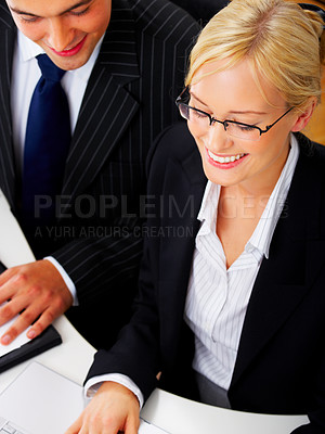 Buy stock photo Portrait of an adorable business woman in an office. Working together with a male colleague. Business man in background.