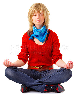 Buy stock photo A young beautiful girl meditating in lotus position. Relaxed, and focused on her inner peace. Unique Keyword for this collection is: meditation123