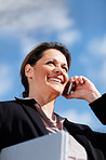 Business woman using a cellphone outdoors