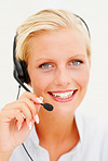 Closeup of a young call centre employee speaking over headset