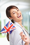 Happy young woman with a Great Britain flag