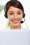 Cute young business woman wearing a headset