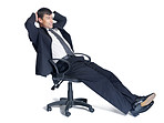 Happy mature business man sitting relaxed on a chair over white