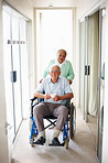 Senior couple at a hospital , man on the wheelchair