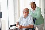 Retired couple at a hospital , man on the wheelchair