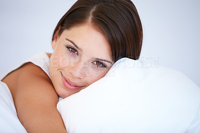 Buy stock photo A gorgeous young woman smiling while lying in bed