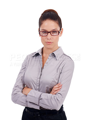 Buy stock photo Studio shot of a stern-looking young business woman with her arms crossed isolated on white