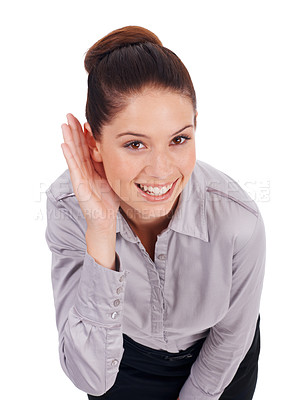 Buy stock photo Studio portrait of a positive-looking young business woman cupping her hand to her ear isolated on white