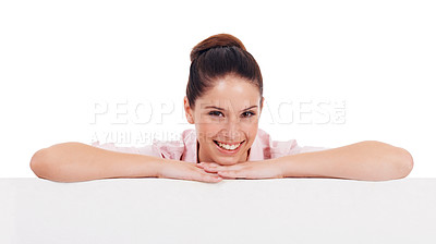 Buy stock photo Studio shot of an attractive young women leaning on a blank placard isolated on white