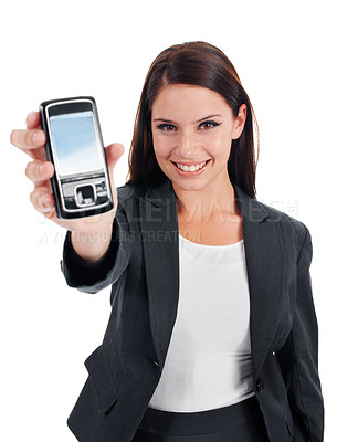 Buy stock photo Studio shot of an attractive young woman holding up a cellphone to the camera isolated on white