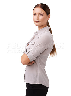 Buy stock photo Cropped shot of an attractive young woman standing with her arms folded isolated on white