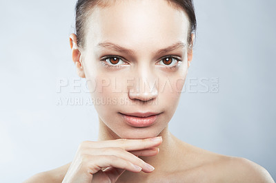 Buy stock photo Head and shoulder portrait of a beautiful young woman in the nude posing with and hand on chin