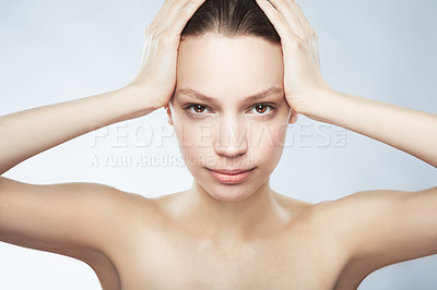 Buy stock photo Cropped portrait of a beautiful young woman in the nude with hands on her head