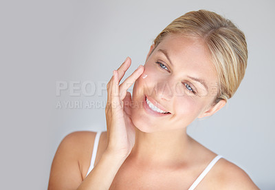 Buy stock photo Cropped shot of a beautiful woman touching her face