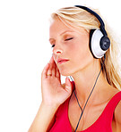 Cute young female listening to music over white