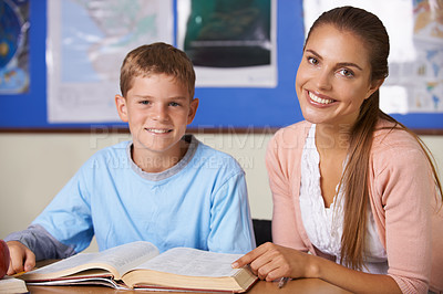 Buy stock photo A beautiful young teacher helping her student to study - portrait
